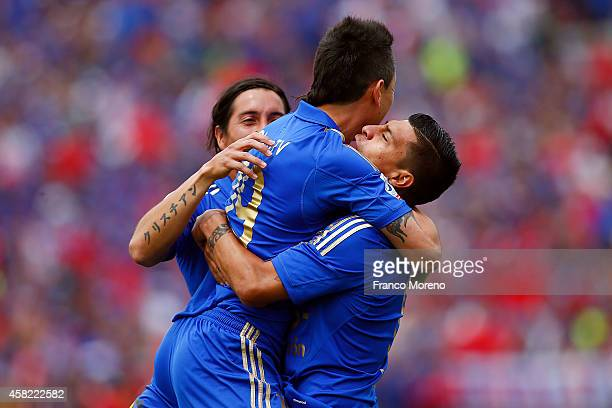 Patricio Rubio of Universidad de Chile celebrates with his teammates after scoring the opening goal during a match between Universidad de Chile and...