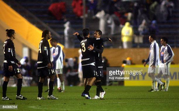 Patricio Urrutia and Renan Calle of Liga de Quito celebrate after defeating Pachuca at the FIFA Club World Cup Japan 2008 semi final match between...