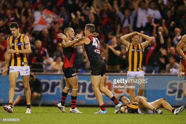 Patrick Ambrose and David Zaharakis of the Bombers celebrate a goal during the AFL Round two match between the Essendon Bombers and the Hawthorn...