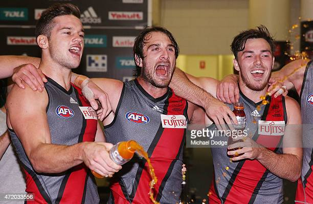 Patrick Ambrose Jobe Watson and Michael Hibberd of the Bombers sing the club song after winning during the round five AFL match between the St Kilda...