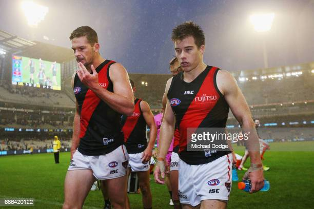 Patrick Ambrose of the Bombers and Zach Merrett looks dejected after winning during the round three AFL match between the Carlton Blues and the...