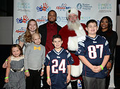 Patrick and CeCe Chung attend Patrick Chung's Open Mic Holiday Party along with Santa and Malia Madison Camryn Matthew and Nathan benefiting Boston...
