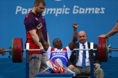 Patrick Ardon of France celebrates a successful lift in the Men's 48kg Powerlifting on day 1 of the London 2012 Paralympic Games at ExCel on August...