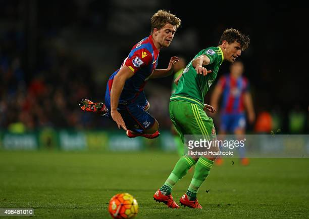 Patrick Bamford of Crystal Palace is tackled by Billy Jones of Sunderland during the Barclays Premier League match between Crystal Palace and...