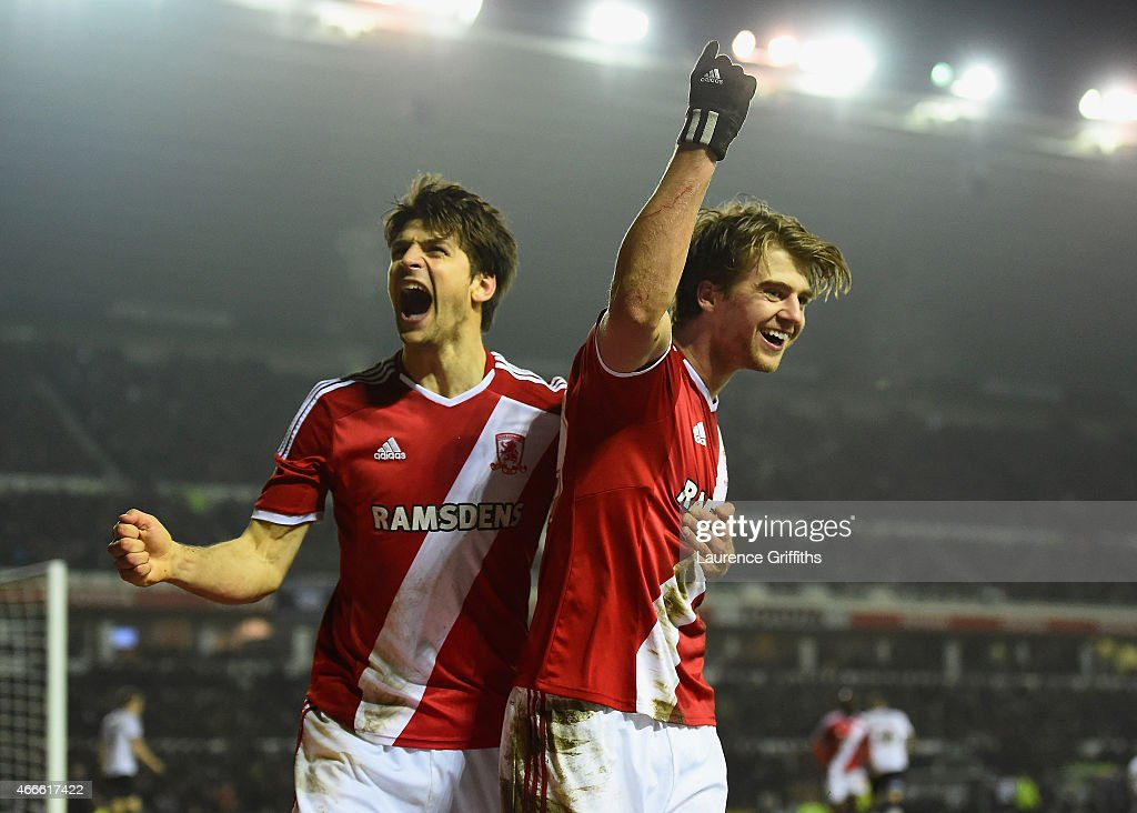 Patrick Bamford of Middlesbrough (R) celebrates scoring the opening goal during the Sky Bet Championship match between Derby County and Middlesbrough at iPro Stadium on March 17, 2015 in Derby, England.