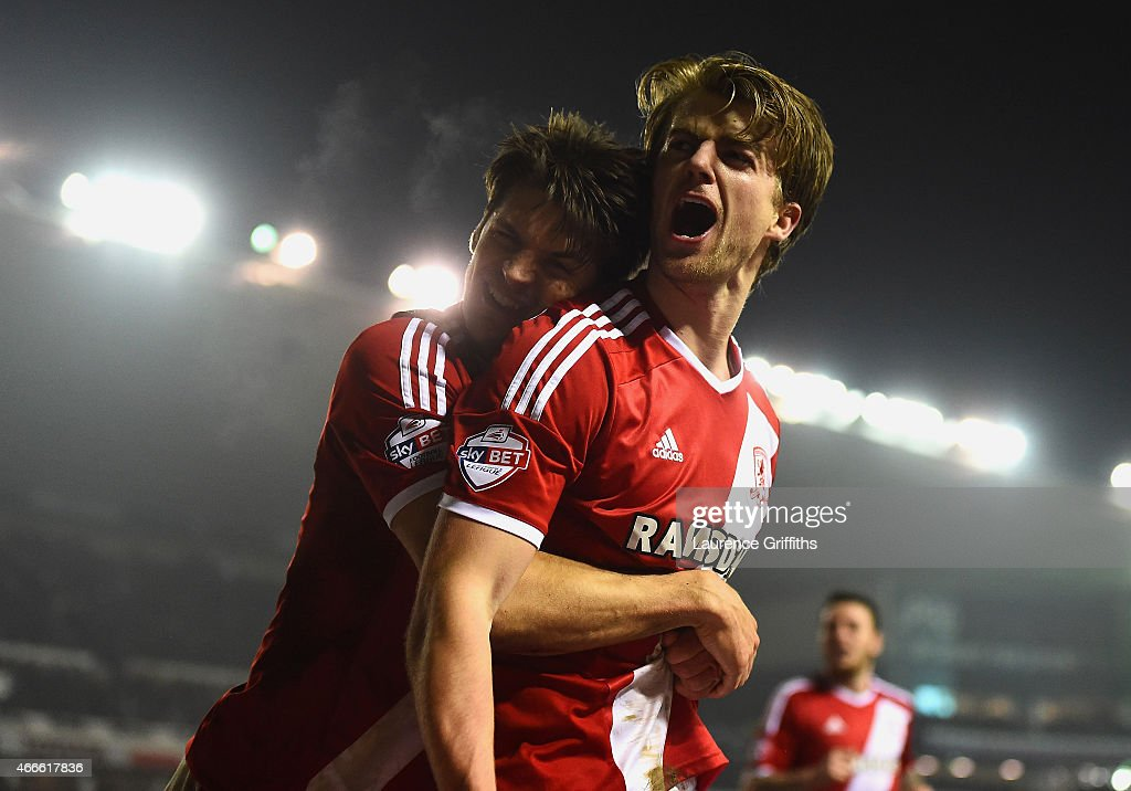 Patrick Bamford of Middlesbrough (R) celebrates scoring the opening goal with George Friend of Middlesbrough during the Sky Bet Championship match between Derby County and Middlesbrough at iPro Stadium on March 17, 2015 in Derby, England.