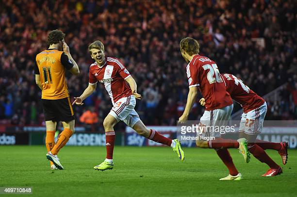 Patrick Bamford of Middlesbrough celebrates with team mates as he scores their second goal during the Sky Bet Championship match between...