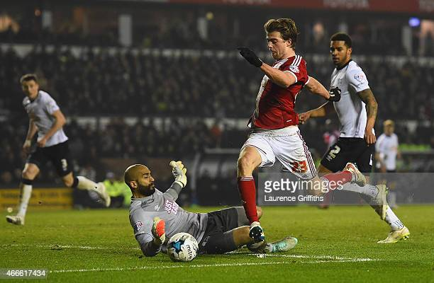 Patrick Bamford of Middlesbrough rounds goalkeeper Lee Grant of Derby to score opening goal during the Sky Bet Championship match between Derby...