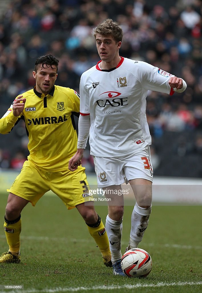 Patrick Bamford of MK Dons controls the ball watched by Paul Black of Tranmere Rovers during the npower League One match between MK Dons and Tranmere Rovers at Stadium MK on March 16, 2013 in Milton Keynes, England.
