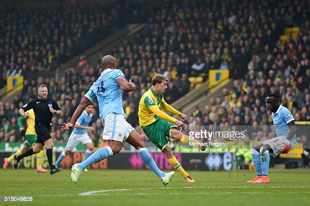 Patrick Bamford of Norwich City shoots at goal during the Barclays Premier League match between Norwich City and Manchester City at Carrow Road on...