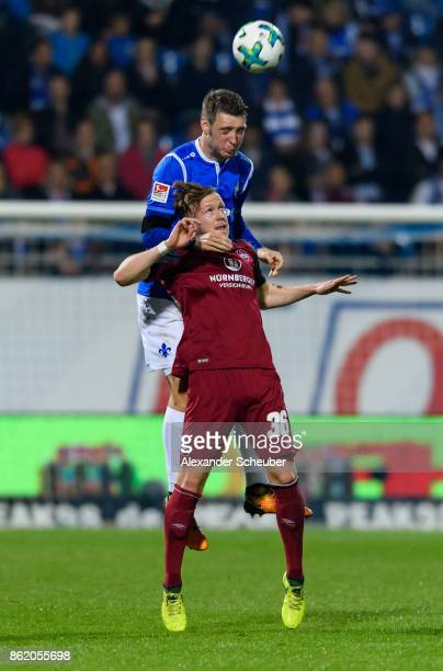 Patrick Banggard of Darmstadt challenges Cedric Teuchert of Nuernberg during the Second Bundesliga match between SV Darmstadt 98 and 1 FC Nuernberg...