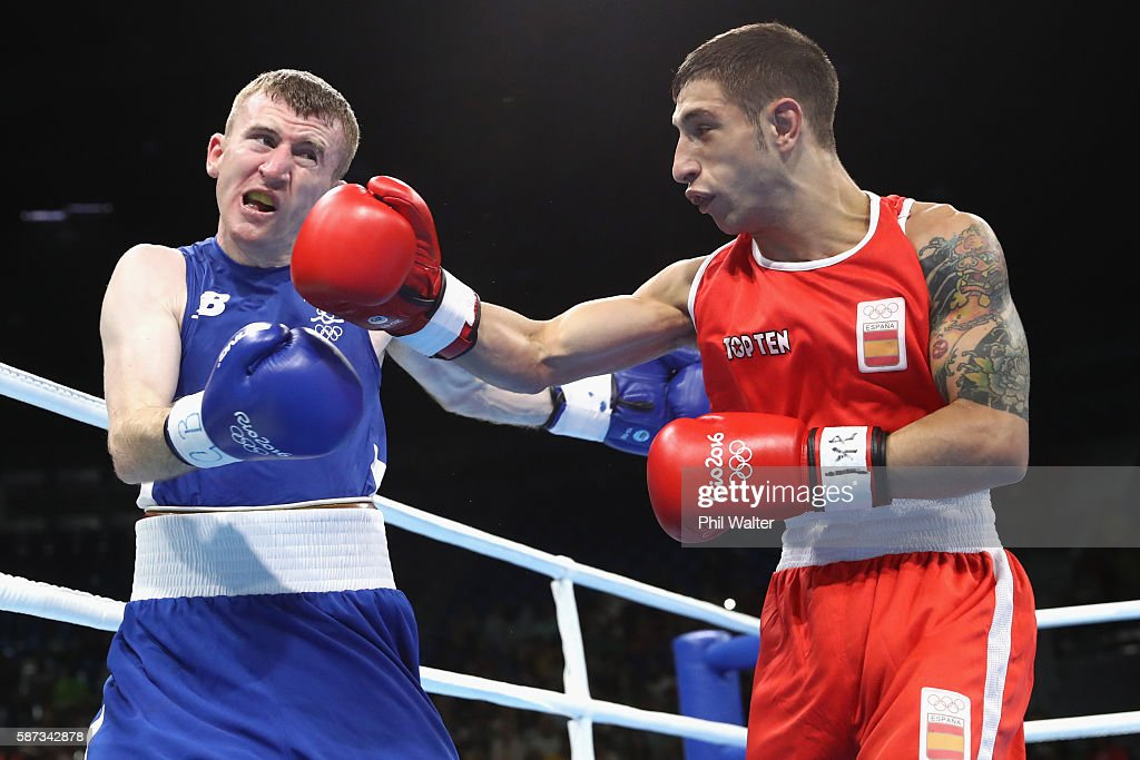 Patrick Barnes of Ireland fights Samuel Heredia Carmona of Spain in their Mens 4649 Light Fly Weight bout on Day 3 of the Rio 2016 Olympic Games at...