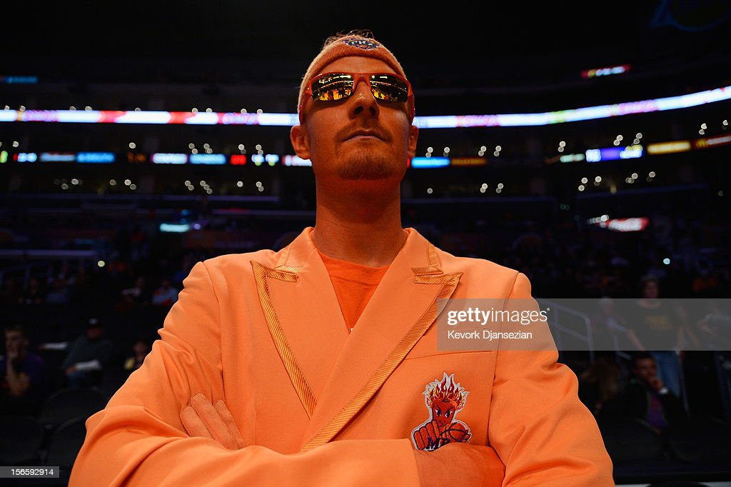 Patrick Battillo a Phoenix Suns fans with orange painted face and jacket waits for the start of the game against Los Angeles Lakers at Staples Center on November 16, 2012 in Los Angeles, California.