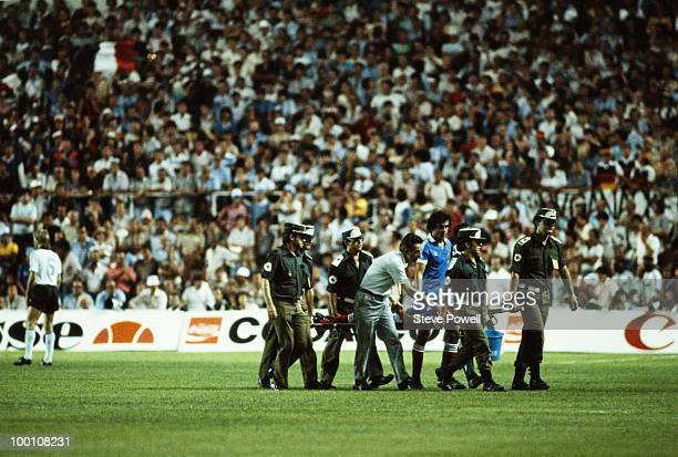 Patrick Battiston of France is carried off the field on a stretcher badly injured with a damaged vertebrae a broken jaw and the loss of four of his...