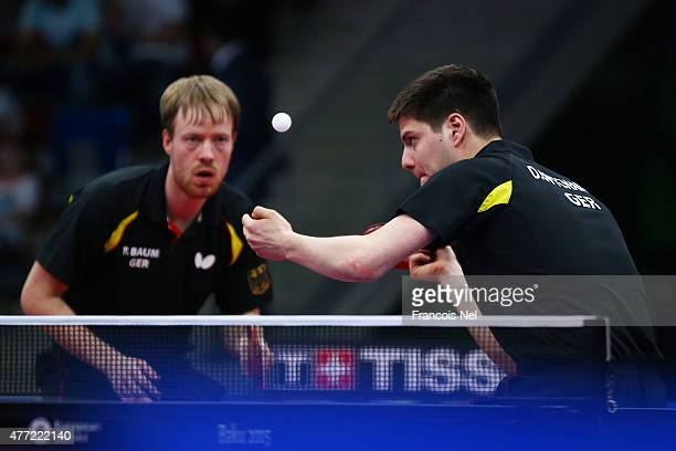 Patrick Baum and Dimitrij Ovtcharov of Germany compete in the Men's Team Table Tennis bronze medal match against Stefan Fegerl and Daniel Habesohn of...