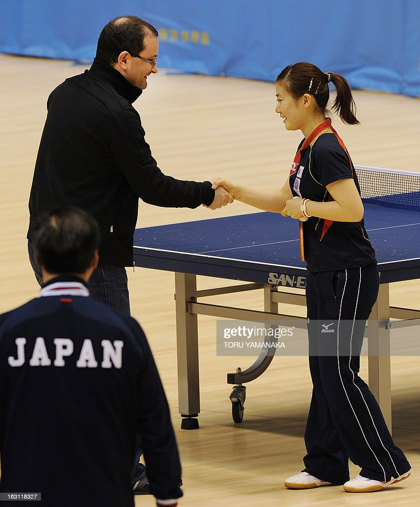 Patrick Baumann (L) of Switzerland, member of the International Olympic Committee (IOC) evaluation commission led by Craig Reedie, shakes hands with Japan's Olympian Ai Fukuhara after they play table tennis during the inspectors' visit to Tokyo Metropolitan Gymnasium, a potential location for the 2020 Olympic Games table tennis, in Tokyo on March 5, 2013. Japan's corporate giants are ready to chip in for another Summer Olympics in Tokyo, hoping the Games will provide the same economic boost as the 1964 edition, Toyota's chairman said on march 5. AFP PHOTO / Toru YAMANAKA