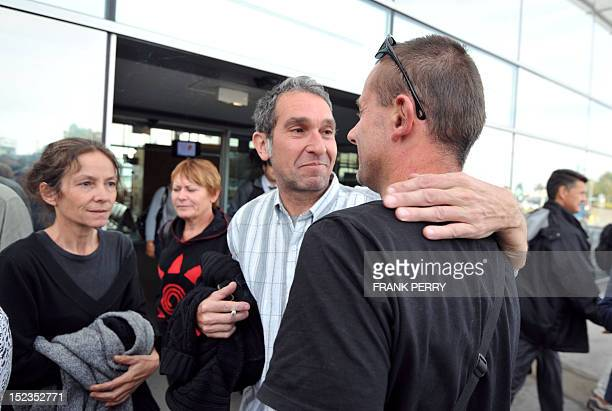 Patrick Bellanger the father of Jeremie Bellanger and his companion Cecile Blanloeil are welcomed back by relatives as they arrive from Bolivia on...
