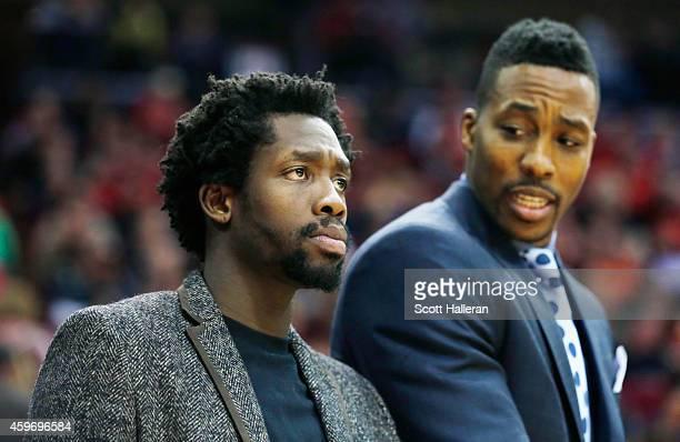 Patrick Beverley and Dwight Howard of the Houston Rockets stand near the team area during their game against the Los Angeles Clippers at the Toyota...