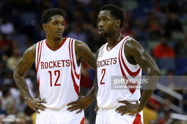 Patrick Beverley of the Houston Rockets and Lou Williams talk during a game against the New Orleans Pelicans at the Smoothie King Center on February...