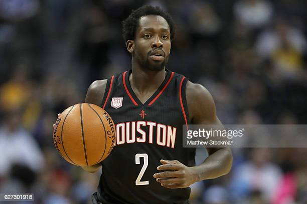Patrick Beverley of the Houston Rockets brings the ball down court against the Denver Nuggets at the Pepsi Center on December 2 2016 in Denver...