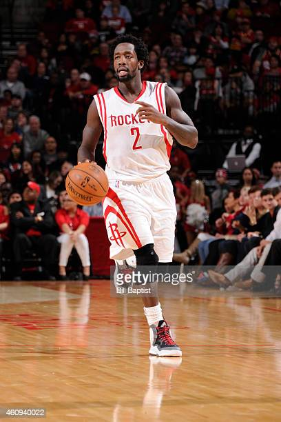 Patrick Beverley of the Houston Rockets brings the ball up court against the Charlotte Hornets on December 31 2014 at the Toyota Center in Houston...