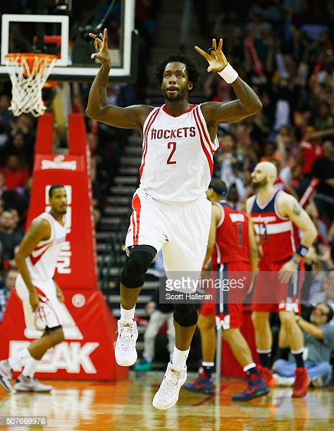 Patrick Beverley of the Houston Rockets celebrates a basket on the court during their game against the Washington Wizards at the Toyota Center on...