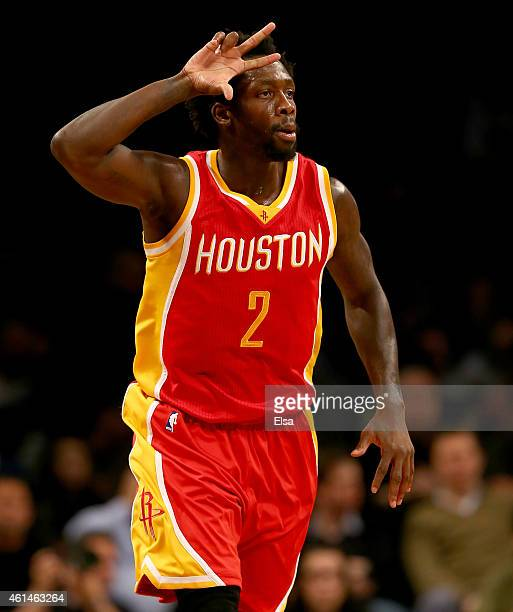 Patrick Beverley of the Houston Rockets celebrates his shot in the second half against the Brooklyn Nets at the Barclays Center on January 12 2015 in...