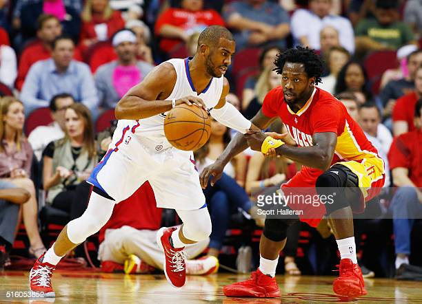 Patrick Beverley of the Houston Rockets defends against Chris Paul of the Los Angeles Clippers during their game at the Toyota Center on March 16...