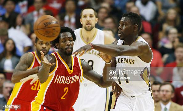 HOUSTON TX DECEMBER18 Patrick Beverley of the Houston Rockets defends against Jrue Holiday of the New Orleans Pelicans during their game at the...