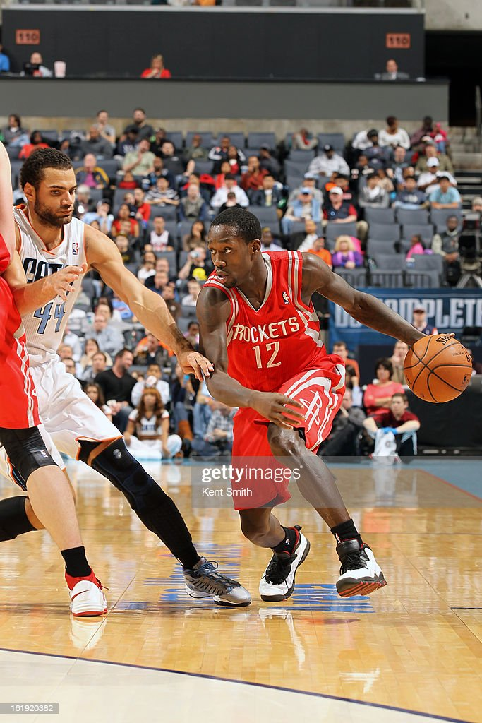 Patrick Beverley #12 of the Houston Rockets drives against Jeffery Taylor #44 of the Charlotte Bobcats at the Time Warner Cable Arena on January 21, 2013 in Charlotte, North Carolina.