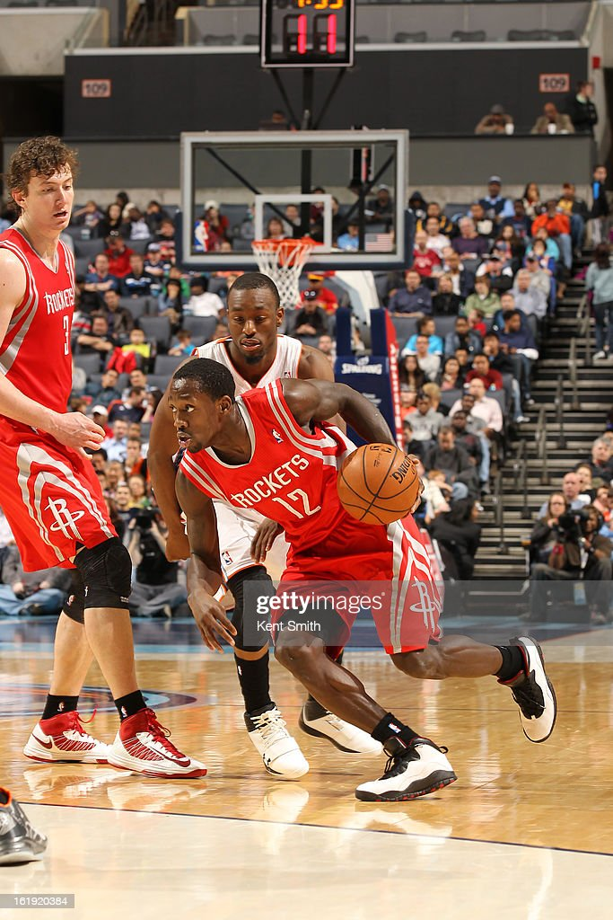 Patrick Beverley #12 of the Houston Rockets drives past Kemba Walker #15 of the Charlotte Bobcats at the Time Warner Cable Arena on January 21, 2013 in Charlotte, North Carolina.