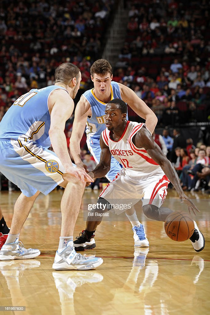 Patrick Beverley #12 of the Houston Rockets drives to the basket against the Denver Nuggets on January 23, 2013 at the Toyota Center in Houston, Texas.