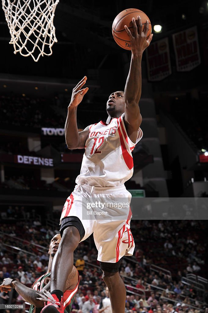 Patrick Beverley #12 of the Houston Rockets drives to the basket against the Milwaukee Bucks on February 27, 2013 at the Toyota Center in Houston, Texas.