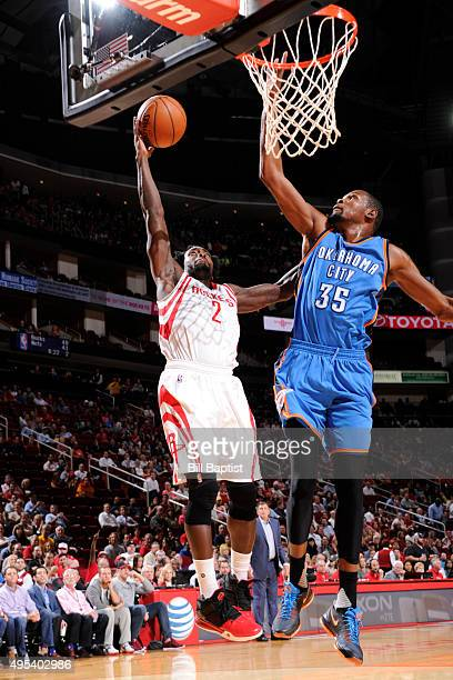 Patrick Beverley of the Houston Rockets goes to the basket against Kevin Durant of the Oklahoma City Thunder on November 2 2015 at the Toyota Center...