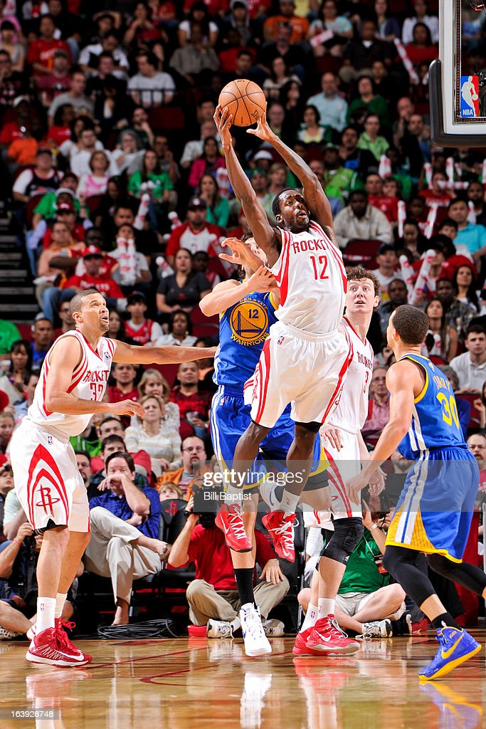 Patrick Beverley #12 of the Houston Rockets grabs a loose ball against the Golden State Warriors on March 17, 2013 at the Toyota Center in Houston, Texas.