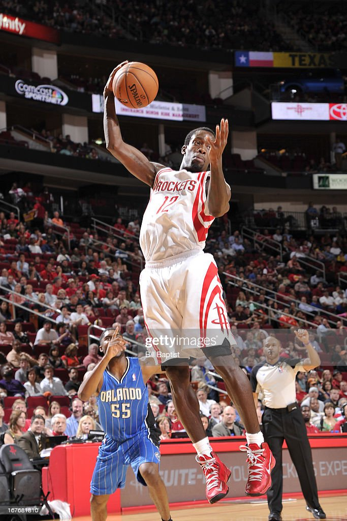 Patrick Beverley #12 of the Houston Rockets grabs a rebound against the Orlando Magic on April 1, 2013 at the Toyota Center in Houston, Texas.