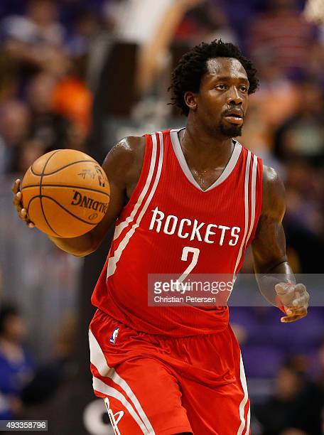 Patrick Beverley of the Houston Rockets handles the ball during the preseason NBA game against the Phoenix Suns at Talking Stick Resort Arena on...