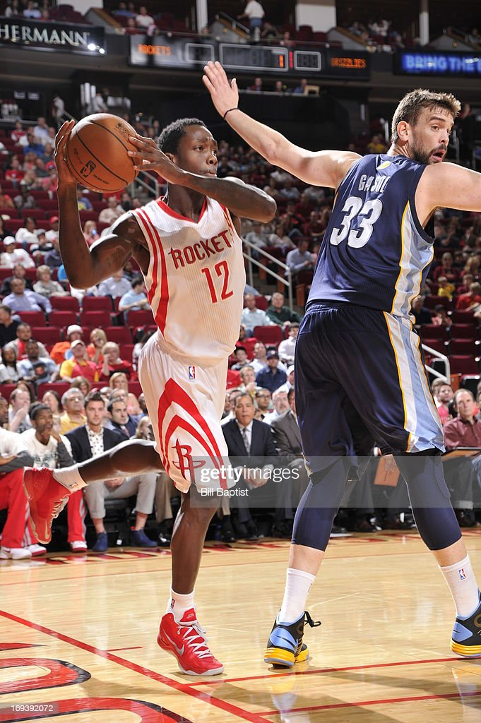 <a gi-track='captionPersonalityLinkClicked' href=/galleries/search?phrase=Patrick+Beverley&family=editorial&specificpeople=4144993 ng-click='$event.stopPropagation()'>Patrick Beverley</a> #12 of the Houston Rockets looks to pass the ball against <a gi-track='captionPersonalityLinkClicked' href=/galleries/search?phrase=Marc+Gasol&family=editorial&specificpeople=661205 ng-click='$event.stopPropagation()'>Marc Gasol</a> #33 of the Memphis Grizzlies on April 12, 2013 at the Toyota Center in Houston, Texas.