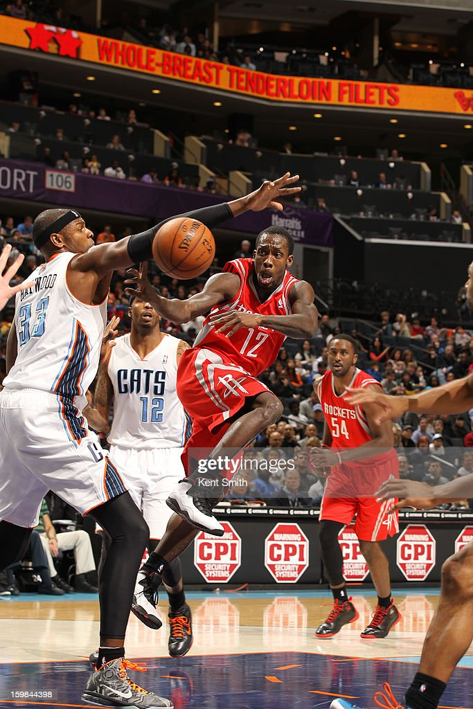 Patrick Beverley #12 of the Houston Rockets passes the ball against Brendan Haywood #33 of the Charlotte Bobcats at the Time Warner Cable Arena on January 21, 2013 in Charlotte, North Carolina.