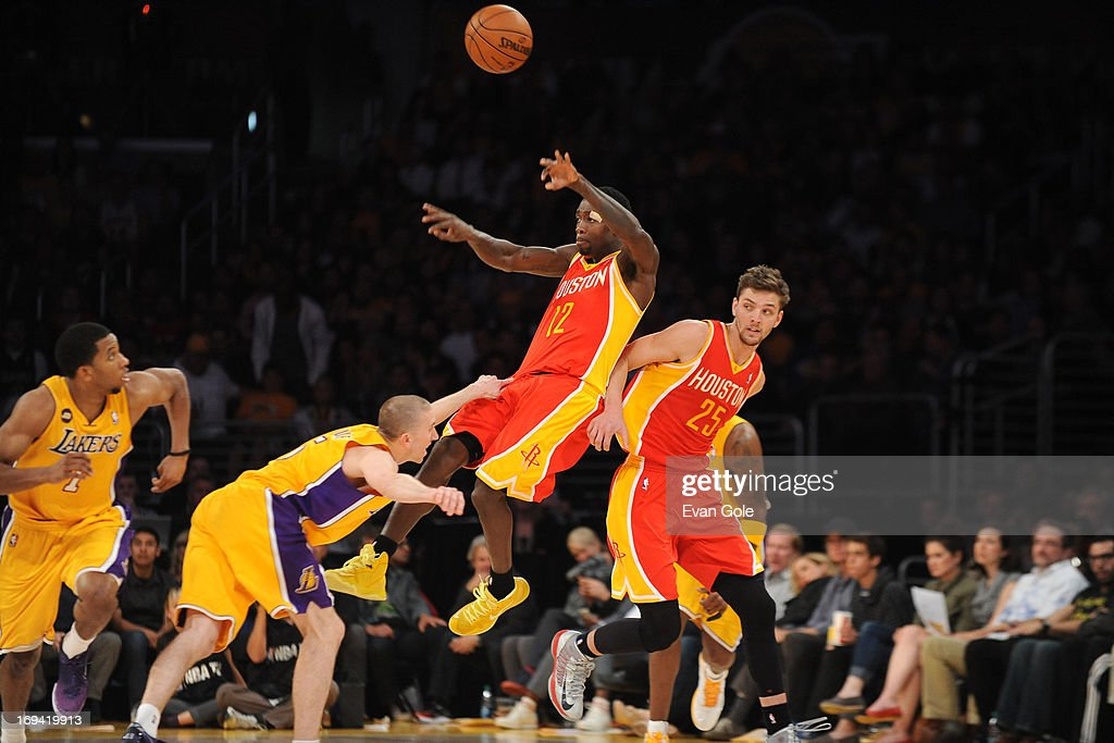 <a gi-track='captionPersonalityLinkClicked' href=/galleries/search?phrase=Patrick+Beverley&family=editorial&specificpeople=4144993 ng-click='$event.stopPropagation()'>Patrick Beverley</a> #12 of the Houston Rockets passes the ball against the Los Angeles Lakers at Staples Center on April 17, 2013 in Los Angeles, California.