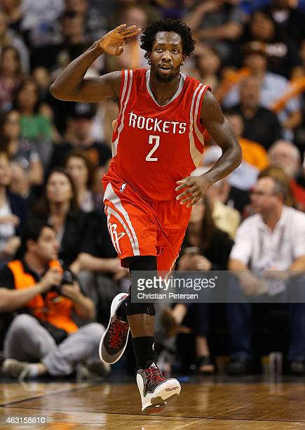 Patrick Beverley of the Houston Rockets reacts after hitting a three point shot against the Phoenix Suns during the second half of the NBA game at US...