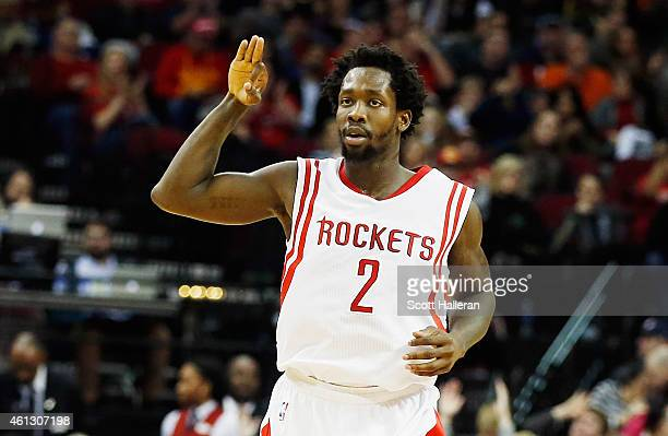 Patrick Beverley of the Houston Rockets reacts to a basket during their game against the Utah Jazz at the Toyota Center on January 10 2015 in Houston...