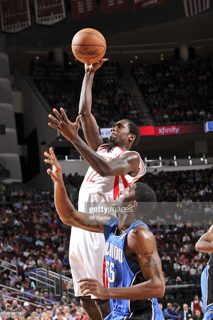 Patrick Beverley #12 of the Houston Rockets shoots against <a gi-track='captionPersonalityLinkClicked' href=/galleries/search?phrase=E%27Twaun+Moore&family=editorial&specificpeople=4877476 ng-click='$event.stopPropagation()'>E'Twaun Moore</a> #55 of the Orlando Magic on April 1, 2013 at the Toyota Center in Houston, Texas.