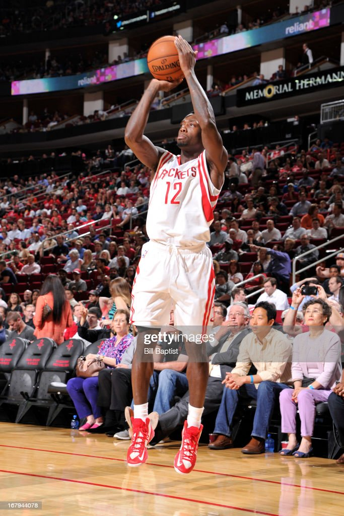 <a gi-track='captionPersonalityLinkClicked' href=/galleries/search?phrase=Patrick+Beverley&family=editorial&specificpeople=4144993 ng-click='$event.stopPropagation()'>Patrick Beverley</a> #12 of the Houston Rockets shoots against the Phoenix Suns on April 9, 2013 at the Toyota Center in Houston, Texas.
