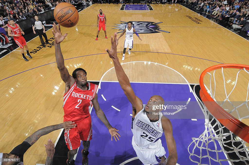 <a gi-track='captionPersonalityLinkClicked' href=/galleries/search?phrase=Patrick+Beverley&family=editorial&specificpeople=4144993 ng-click='$event.stopPropagation()'>Patrick Beverley</a> #2 of the Houston Rockets shoots against <a gi-track='captionPersonalityLinkClicked' href=/galleries/search?phrase=Travis+Outlaw&family=editorial&specificpeople=203322 ng-click='$event.stopPropagation()'>Travis Outlaw</a> #25 of the Sacramento Kings on December 15, 2013 at Sleep Train Arena in Sacramento, California.