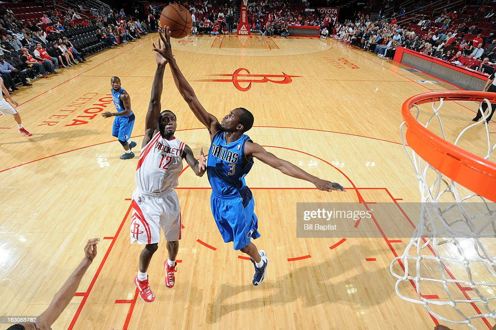 Patrick Beverley #12 of the Houston Rockets shoots the ball against <a gi-track='captionPersonalityLinkClicked' href=/galleries/search?phrase=Rodrigue+Beaubois&family=editorial&specificpeople=5299423 ng-click='$event.stopPropagation()'>Rodrigue Beaubois</a> #3 of the Dallas Mavericks on March 3, 2013 at the Toyota Center in Houston, Texas.
