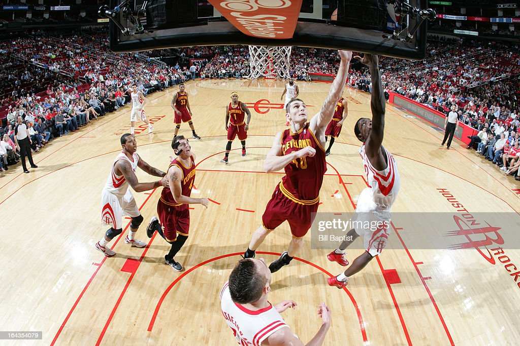 Patrick Beverley #12 of the Houston Rockets shoots the ball against <a gi-track='captionPersonalityLinkClicked' href=/galleries/search?phrase=Tyler+Zeller&family=editorial&specificpeople=5122156 ng-click='$event.stopPropagation()'>Tyler Zeller</a> #40 of the Cleveland Cavaliers on March 22, 2013 at the Toyota Center in Houston, Texas.