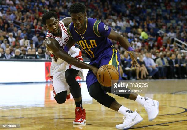 Patrick Beverley of the Houston Rockets steals the ball from Jrue Holiday of the New Orleans Pelicans during the first half of a game at the Smoothie...