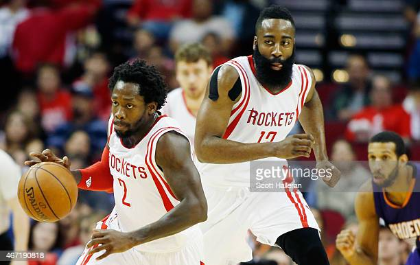 Patrick Beverley of the Houston Rockets takes the basketball up the court in front of James Harden during their game against the Phoenix Sunsat the...
