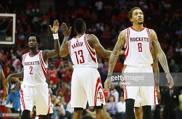 Patrick Beverley Timberwolves James Harden and Michael Beasley of the Houston Rockets wait on the court during their game against the Minnesota...